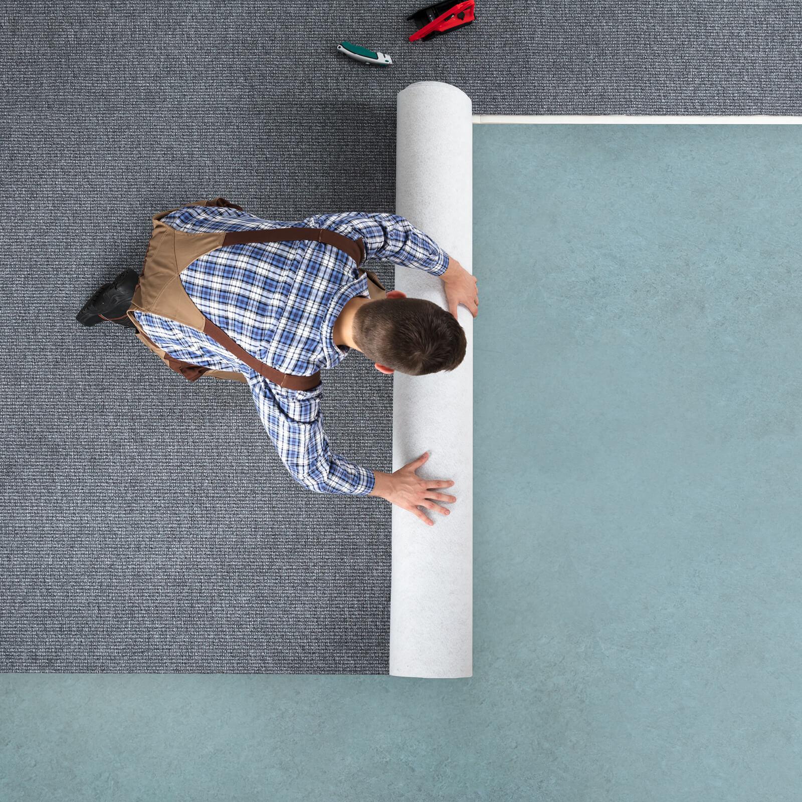 Man installing carpet   Noble Floors LLC
